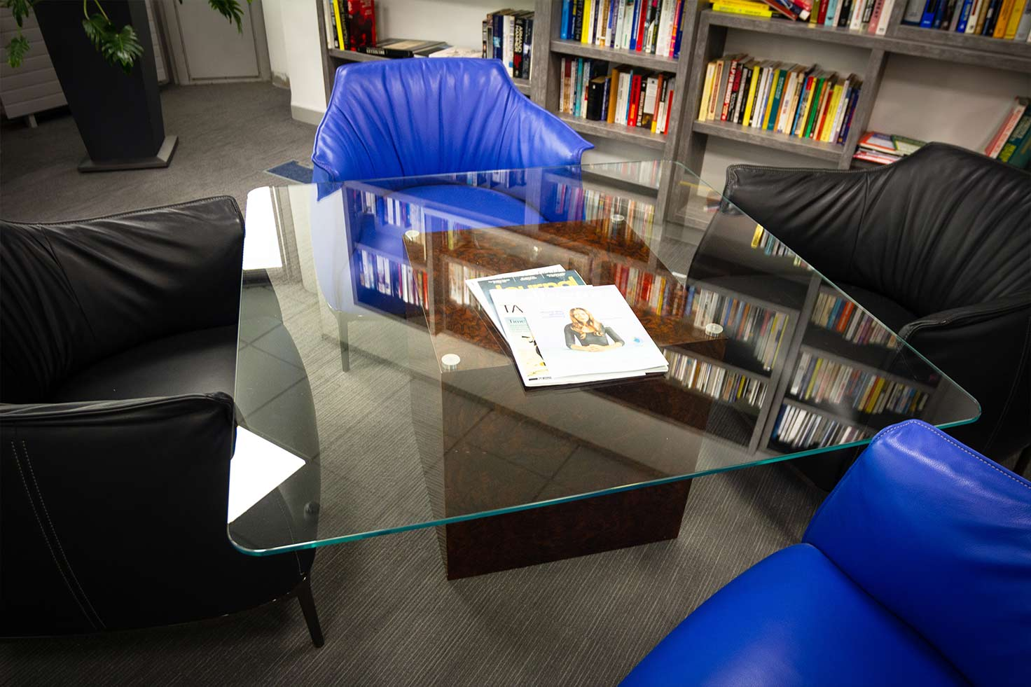 Bespoke glass table at Clyde Blowers Capital Ltd - Designed and Installed by Jack Hyams