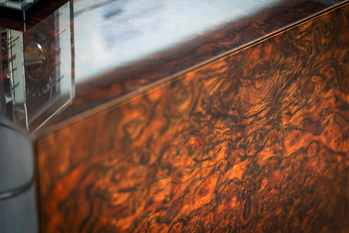 Closeup shot of a bespoke walnut desk at Clyde Blowers Capital Ltd - Designed and Installed by Jack Hyams